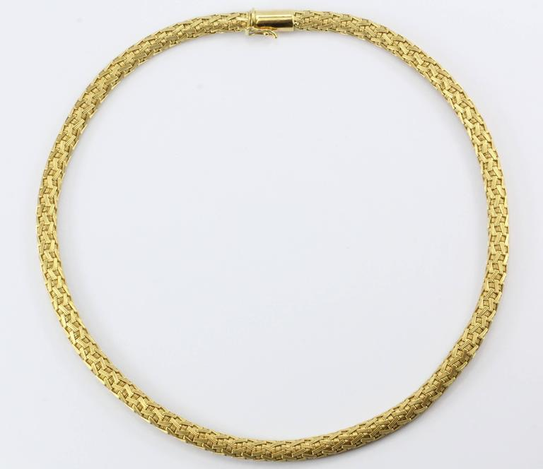 "Vintage Roberto Coin 18K Gold Woven Silk Necklace. The necklace is in excellent estate condition and ready to wear. It is signed "" 18K ITALY *1226 VI "". 1226 VI is Roberto Coins Italian government registered jeweler number in Venice. The pattern is"