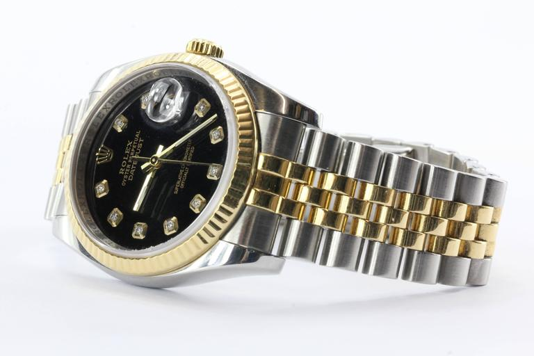 Rolex Oyster Perpetual Date Just 116233 Steel & 18K Gold Diamond Black Watch. The watch is in excellent gently used estate condition, keeping great time and ready to wear. Comes with original box but no paperwork. The case is 18K yellow gold and