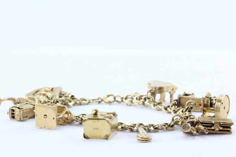 14k Gold 12 Movable Charms Charm Bracelet Circa 1950 S The Piece Is In Excellent Estate