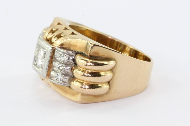 18K Gold Transition Cut Diamond in Platinum French Art Deco Tank Ring Circa 1940's. The ring is in excellent antique estate condition and ready to wear. The ring is hallmarked with the french eagle and dog head mark for 18K gold with platinum. It