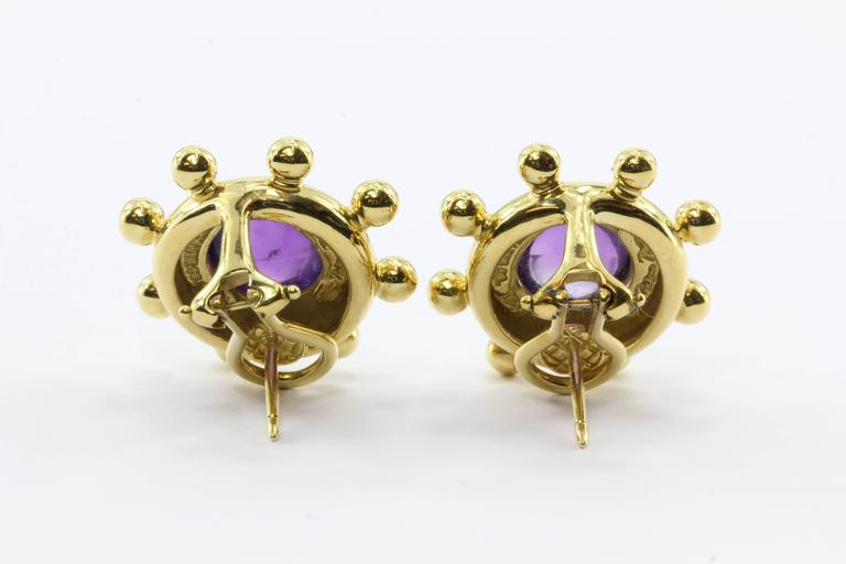 "Tiffany & Co. Paloma Picasso 18K Yellow Gold  Amethyst Clip Post Earrings. The earrings are in excellent estate condition, ready to wear. The earrings are signed ""Tiffany & Co 750 Paloma Piccaso"". The earrings are set with"