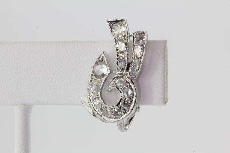 Art Deco 14K White Gold Rose & Old Mine Cut Diamond Earrings. The earrings are in excellent antique estate condition and ready to wear. The earrings are hallmarked 14K. The earring backs are most likely a later addition. The earrings are set