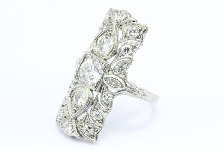 Art deco platinum three stone old european diamond shield for What is platinum jewelry made of