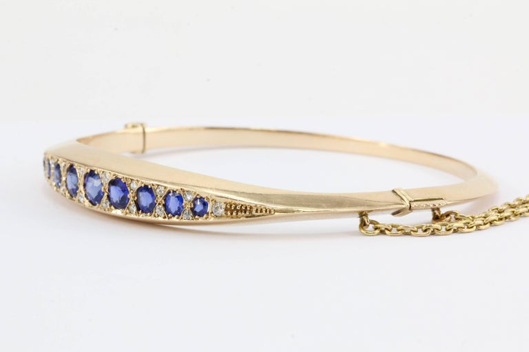 Victorian 15k Gold Natural Sapphire & Old Mine Diamond Bangle Bracelet c.1890's  Era: Victorian, of English Origin  Composition: 15K Yellow Gold  Primary Stone: Natural Blue Sapphires  Stone Carat: 2.25 ctw  Accent Stone: 18 Old Mine Cut