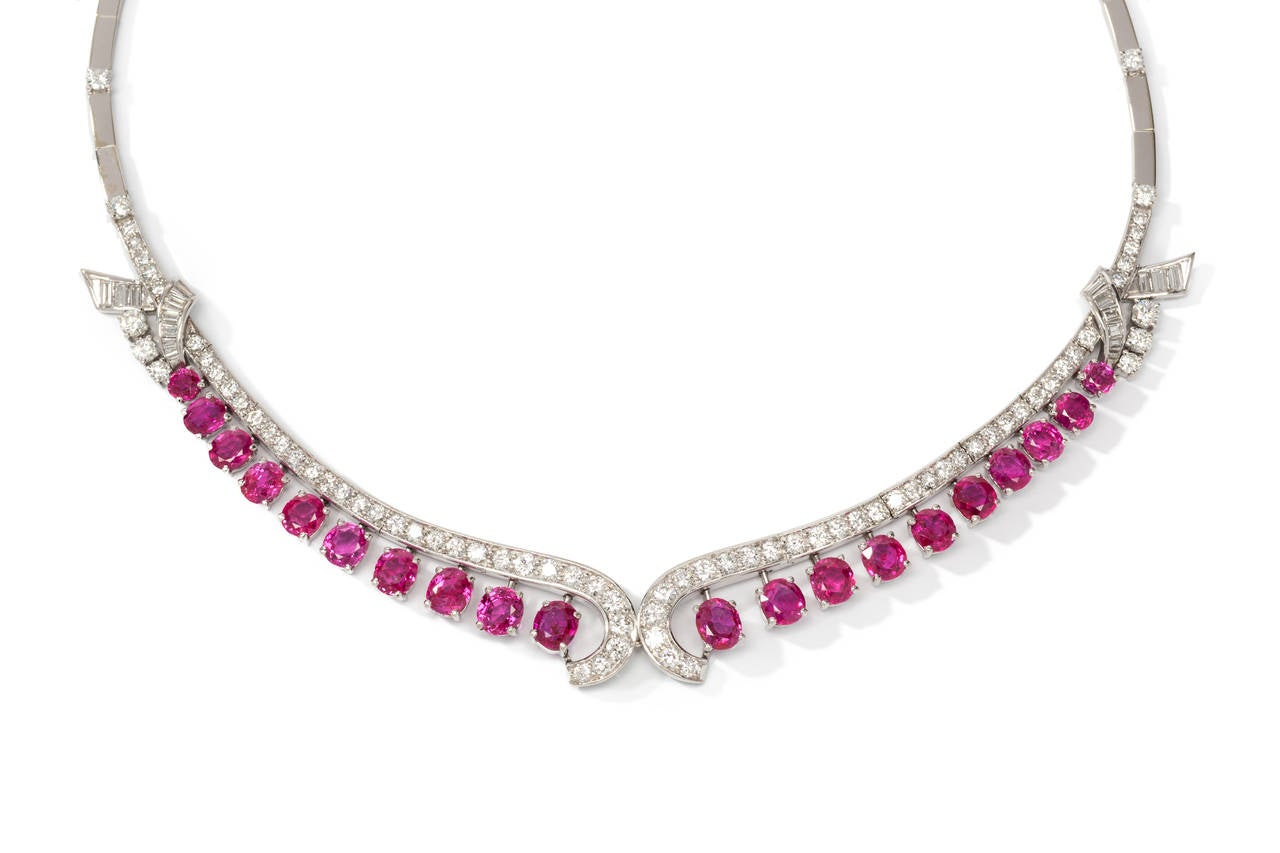 Art Deco Set with 20 faceted rubies and one cabochon-cut ruby with total weight of circa 26,44 carats. 20 baguette-diamonds weighing ca. 1.67 ct. 86 brilliant-cut diamonds with a total weight of circa 8.95 ct. Mounted in 18 K white gold. Hallmarked