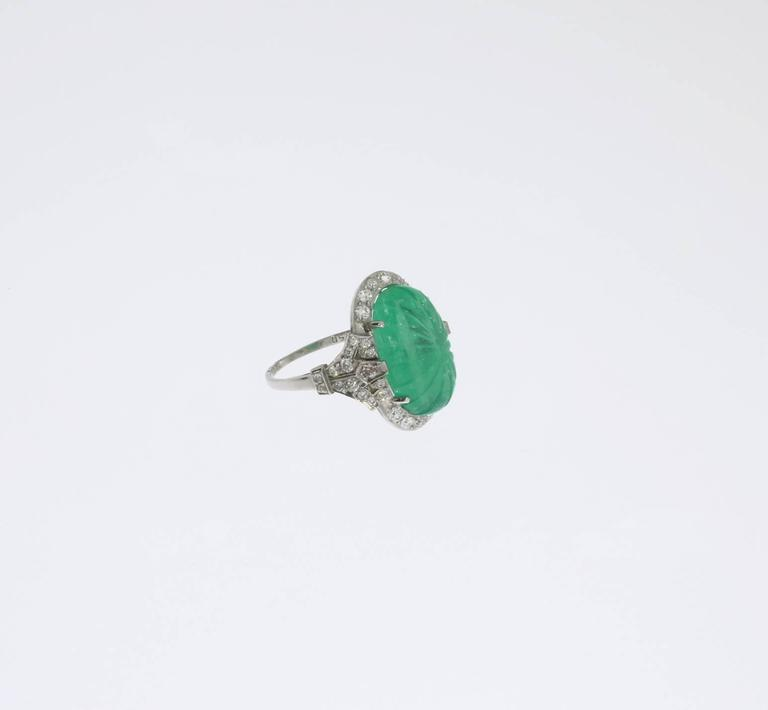 Platinum Ring with Carved Emerald and Diamonds 3