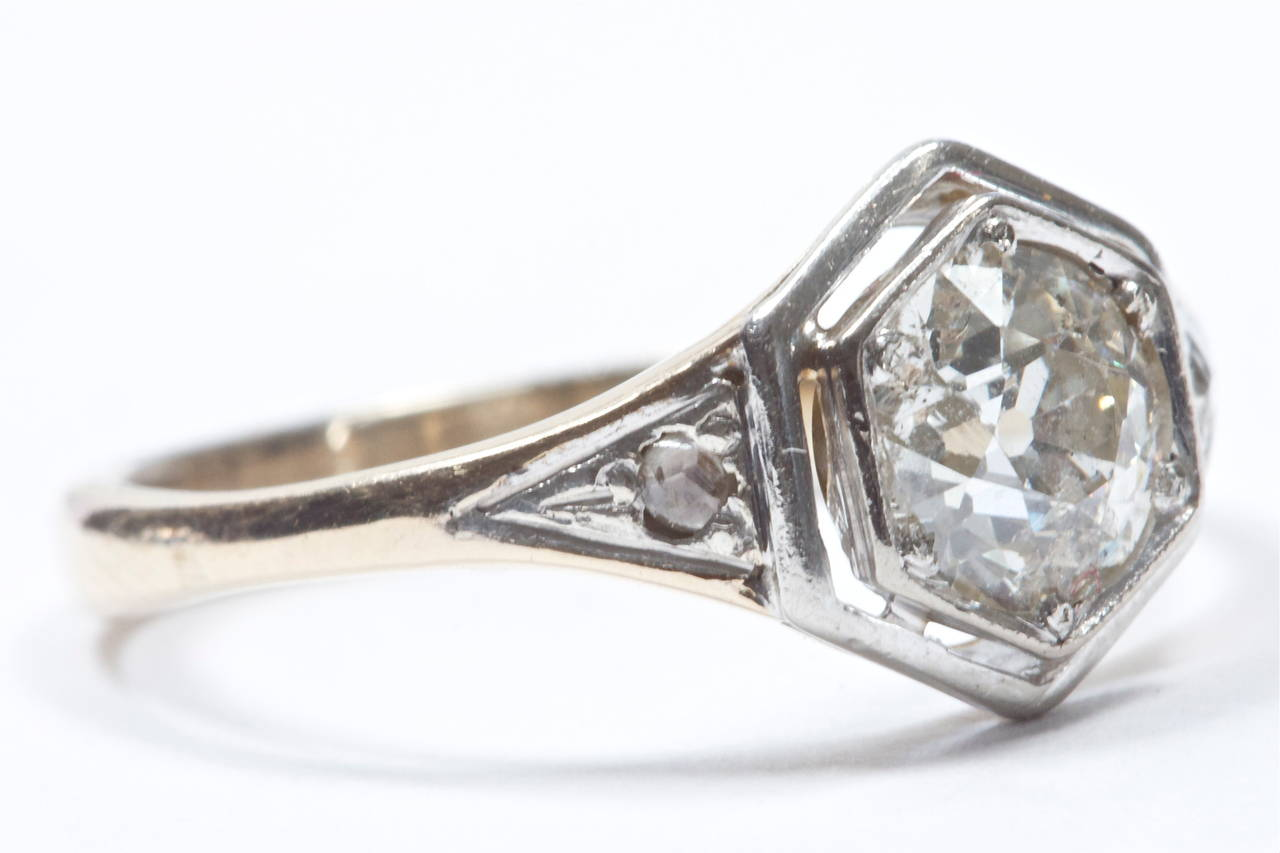 Classic art deco diamond engagement ring with old European cut 0.91 carat center stone. In 14k gold with accenting diamonds.  Size 6 1/4 and can be re-sized.