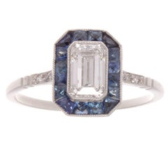 0.68 Carat Emerald Cut Diamond Sapphire Platinum Ring