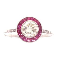 Round Brilliant 0.65 Carat Diamond Ruby Platinum Engagement Ring
