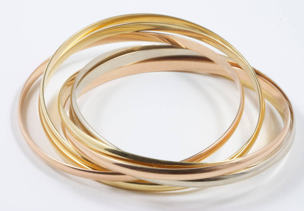 Cartier Seven Bangle Gold Trinity Bracelet In Excellent Condition For Beverly Hills Ca