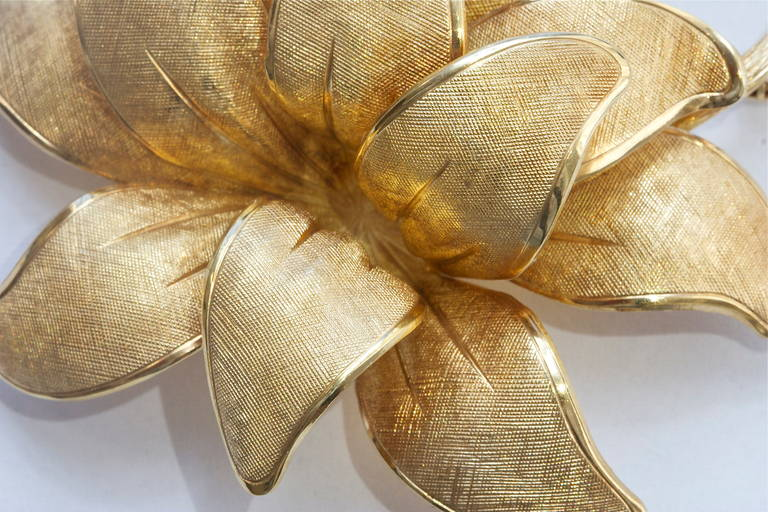 One of Tiffany's more sensual works. Soft, undulating petals on a firm stem. Crafted in 14k gold and stamped Tiffany & Co. Germany.