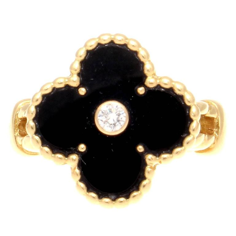 Staying true to the first Alhambra design which was created in 1968 to symbolize luck, health, fortune and love from Van Cleef & Arpels. Designed with jet black onyx that is decorated with a single round cut white diamond in the center weighing 0.06
