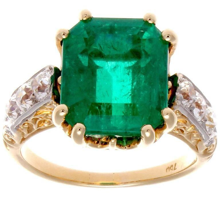 This gem Colombian emerald exhibits a rich, lively forest green color. A good example of old Colombian Muzo mine material. Rare and sought after in fine emeralds. The emerald weighs 5.05 carats and is certified by the AGL lab as Colombian in origin.