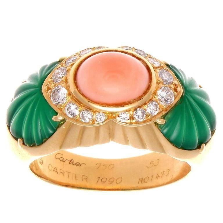 With Cartier's expertise and know how they have been fascinating jewelry collectors with their superior designs for centuries. Creating an explosion of color with a perfect combination of pink angel skin cabochon cut coral accented by shoulders of