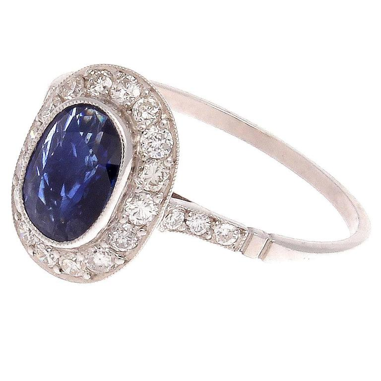 Oval Cut Sapphire Diamond Platinum Ring For Sale