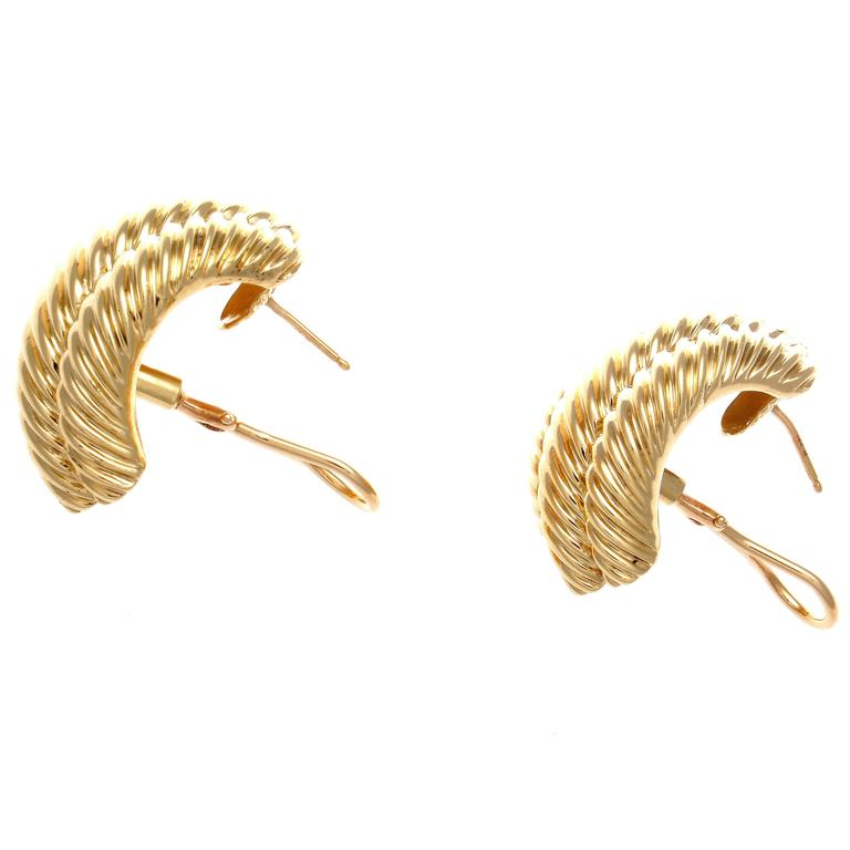 The twisted helix known as the cable design was first introduced in 1983 and is still David Yurman's most sought after creations. Designed in rolling contours of glistening 14k yellow gold that cascade down the ear. Signed David Yurman.  1-1/8