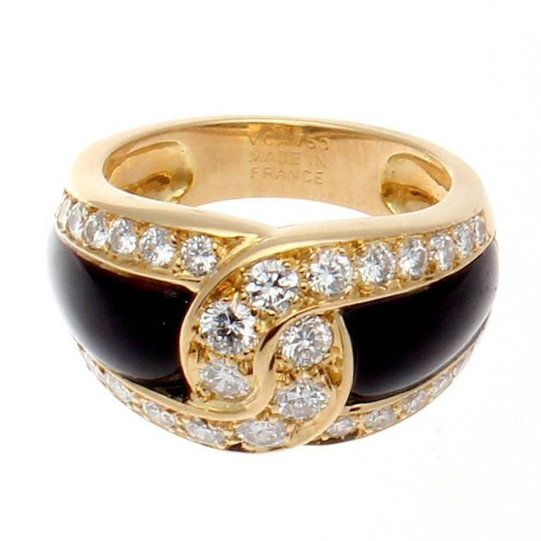 Van Cleef & Arpels, a long rich history of trend setting fashion that is still relevant today. The sleek black onyx has been joined together by the numerous near colorless diamonds. Crafted in 18k yellow gold. Signed VCA France and numbered.  Ring