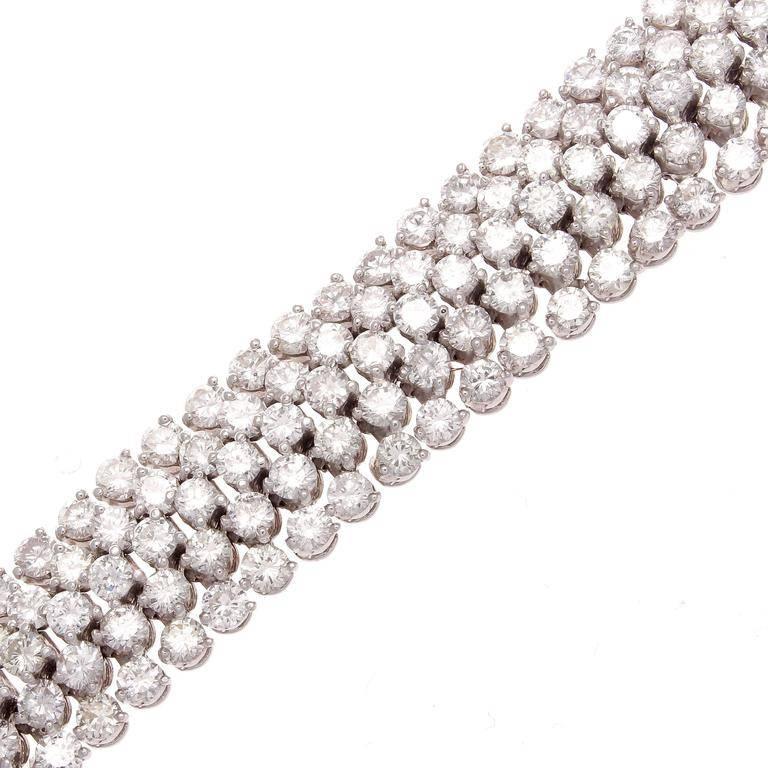 Modern Approximately 24 Carat Diamond Gold Bracelet For Sale