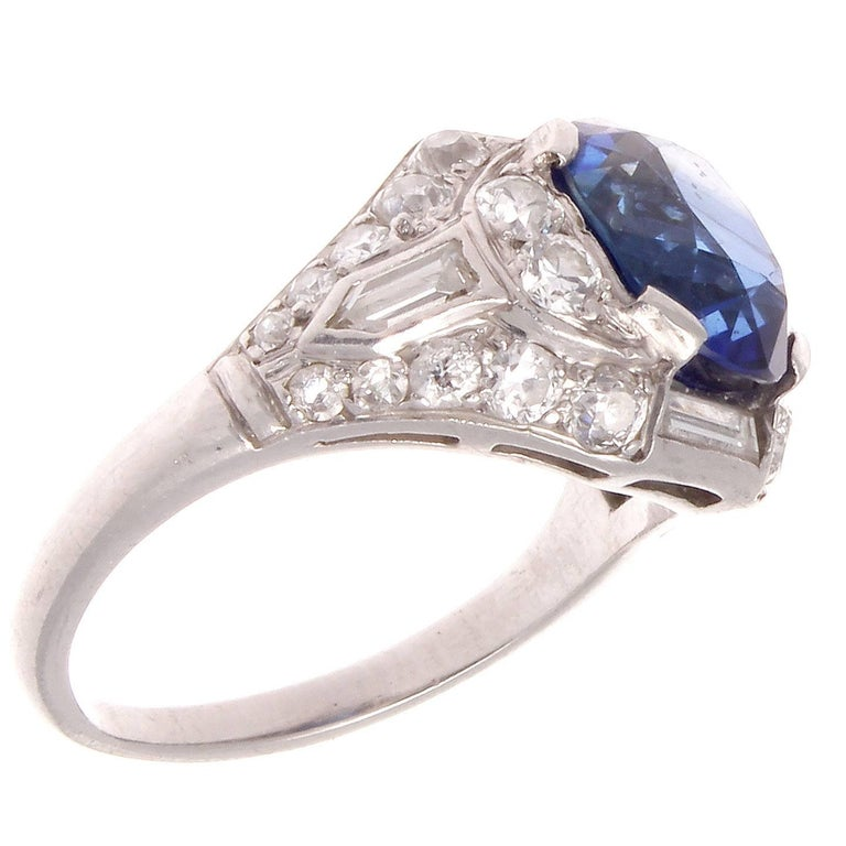 Art Deco brilliance is predicated from the combination of color, symmetry and elegance that is portrayed through its unique designs. Featuring an approximately 4 carat royal blue sapphire that is considered as gem quality because of it's rich color