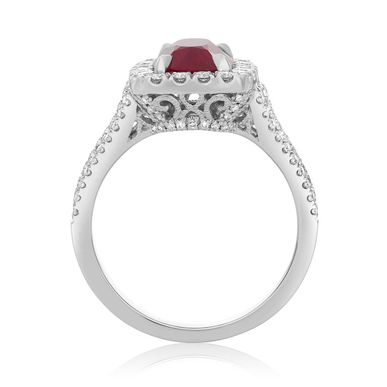 GIA certified 3.09 carat Cushion Cut Ruby ring with pave diamond halo. Split shank design with pave diamonds running one quarter way down the shank. Ruby is the July birthstone making this a perfect gift for any occasion for the July babies in your