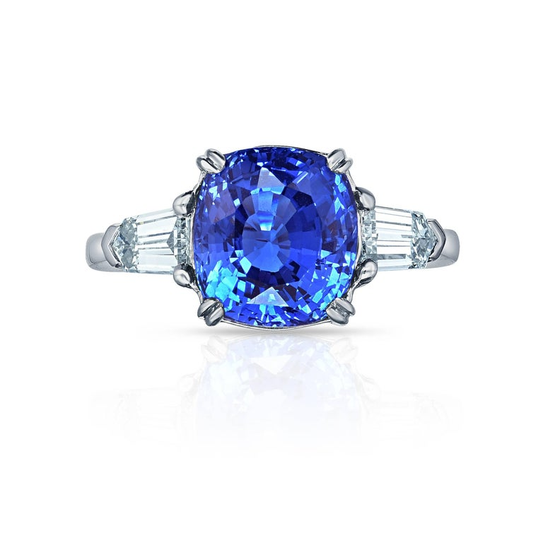 Marisa Perry Three Stone Sapphire Diamonds Ring in Platinum. Marisa Perry Three Stone Ring featuring a 4.49 carat GIA Certified Natural Blue Cushion Cut Sapphire with perfectly matching Bullet Baguette Diamonds. Crafted in platinum to the exact