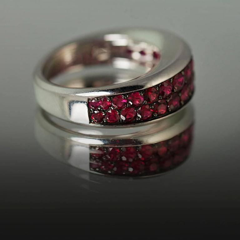 18k White Gold Ring by Mauboussin of Paris containing 1.98 carats of fine round natural rubies..