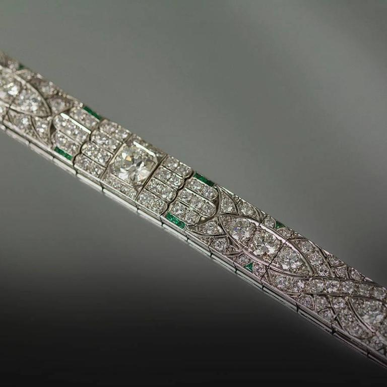 Stunning Platinum Art Deco Bracelet Circa 1930 with 1 Old Euro Diamond Weighing Approx. 2.00 Carats and Smaller Old Euro Diamonds Weighing Approx. 15.00 Carats. Emeralds Weigh Approx. 1.00 Carats.