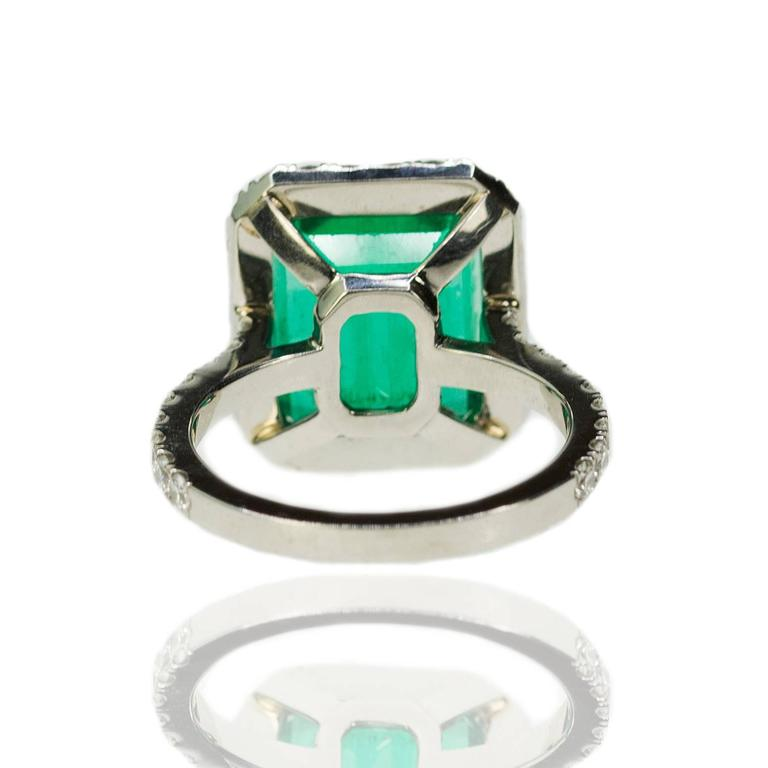 "Ring with 6.64 carat AGL certified ""Minor"" Colombian Emerald set in 18k mounting with 1.40 carats of round brilliant diamonds. 8.27g"