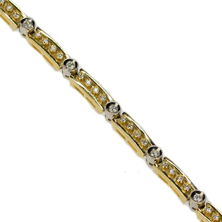 18k Yellow & White Gold Bracelet with 45 modern round brilliant diamonds weighing aproximately 1.60 carats. 31.97g