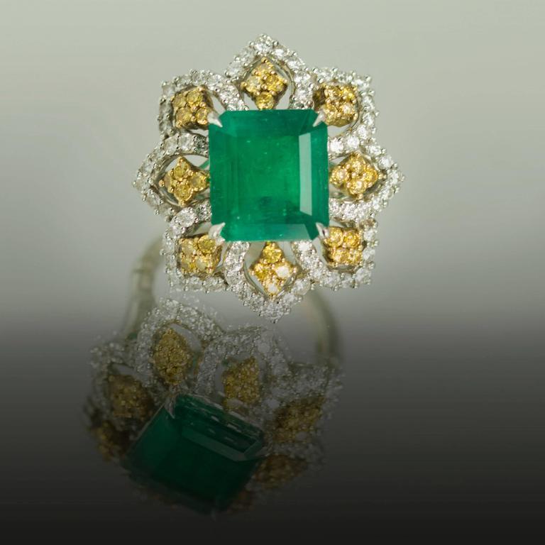 Modern Emerald Yellow Diamond Platinum Ring For Sale