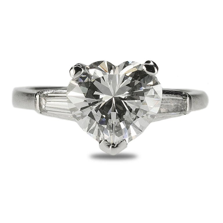 This is the prettiest heart shape diamond on the planet! GIA certified H color VS1 clarity 2.52 carat heart shape diamond set in platinum ring with two colorless tapered baguette diamonds.