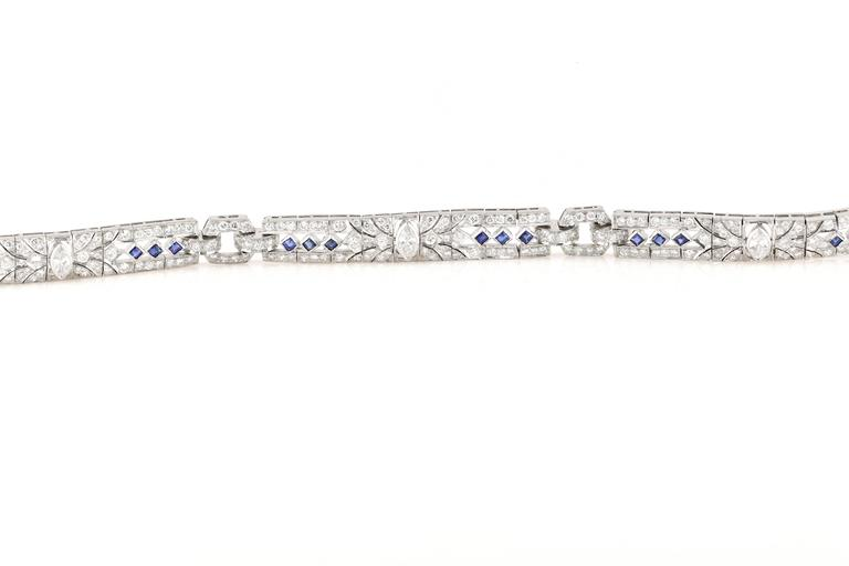 Get the look of art deco, without the premium price. This exquisite replica bracelet is set with diamonds and sapphires throughout. It is also set in 18kt white gold, not 14kt making it a much more premium piece. The sapphire are all Asscher/Square