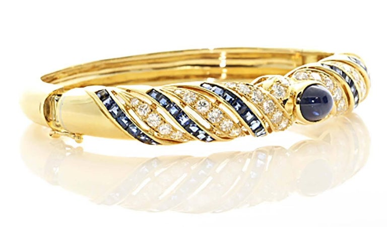 A truly gorgeous bangle bracelet that you can wear daily. Lilly is an amazing jewelry designer using only the finest of materials. The sapphire and diamond inlay is perfectly calibrated creating a gorgeous look. The center cabochon sapphire is a