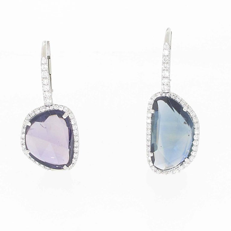 The most unique pair of earrings on 1stDibs. This mismatched pair of amoeba sapphires works for the day or night. They are both very saturated in color, one being purple and the other being blue. The sapphires are cut in a rose cut fashion which