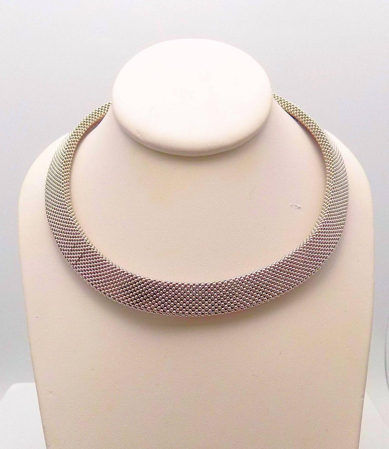 Classic Italian Design on this 14 Karat White Gold and 14 Karat Yellow Gold Woven Necklace 13.5 MM Wide, Length 17