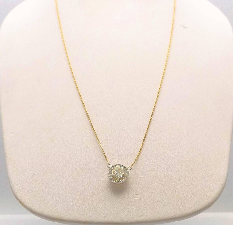 14 Karat White Gold and Yellow Gold Diamond Solitaire Bezel Set Pendant For Sale 1
