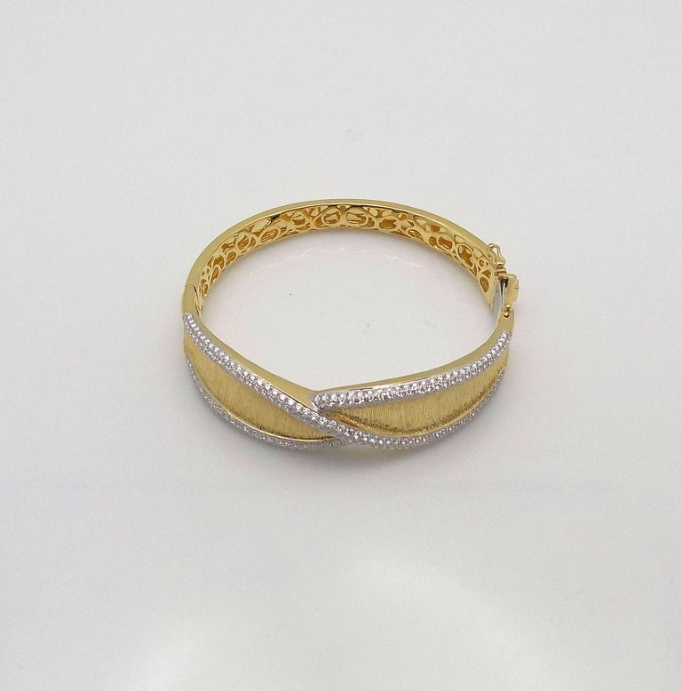 18 Karat Yellow Gold and White Gold Hinged Bracelet Featuring 362 Round Brilliant Diamonds 1.75 Carat Total Weight, VS, G, Signed: JYE'S 22145. 26.6 DWT or 41.37 Grams; 3/4
