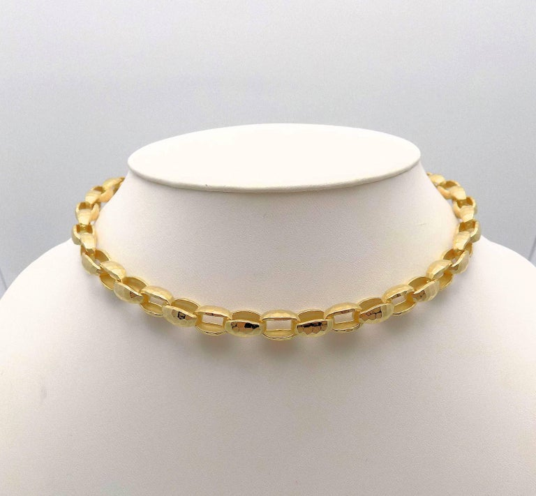 Classic Beauty Describes this 14 Karat Yellow Gold Hammered Oval Rolo Link Necklace has Toggle Catch with Sapphire End Caps, (2) 6 MM Round Cabochon Cut Sapphires, 8 MM Wide, 18