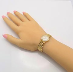 Baume & Mercier Ladies Yellow Gold Diamond Wristwatch