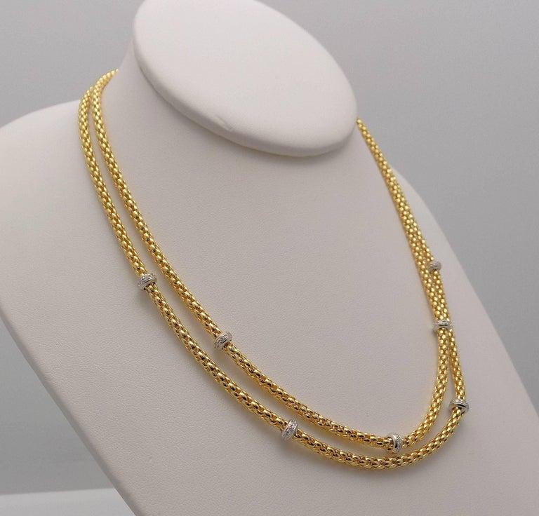 Elegant 18 Karat Yellow Gold & White Gold Double Strand Necklace Featuring 7 Diamond Rondelles; 56 Round Brilliant Diamonds 0.60 Carat Total Weight; SI, H 17