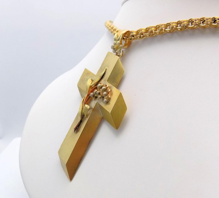 Awe-inspiring 14 Karat Yellow Gold Antique Cross Pendant & Chain.  Dramatic 3-D Effect on this Large Cross with Applied Lilly of the Valley Floral Motif, Excellent Condition; Chain Is Curved Link, Handmade, Several Repairs on Chain (Good Condition).