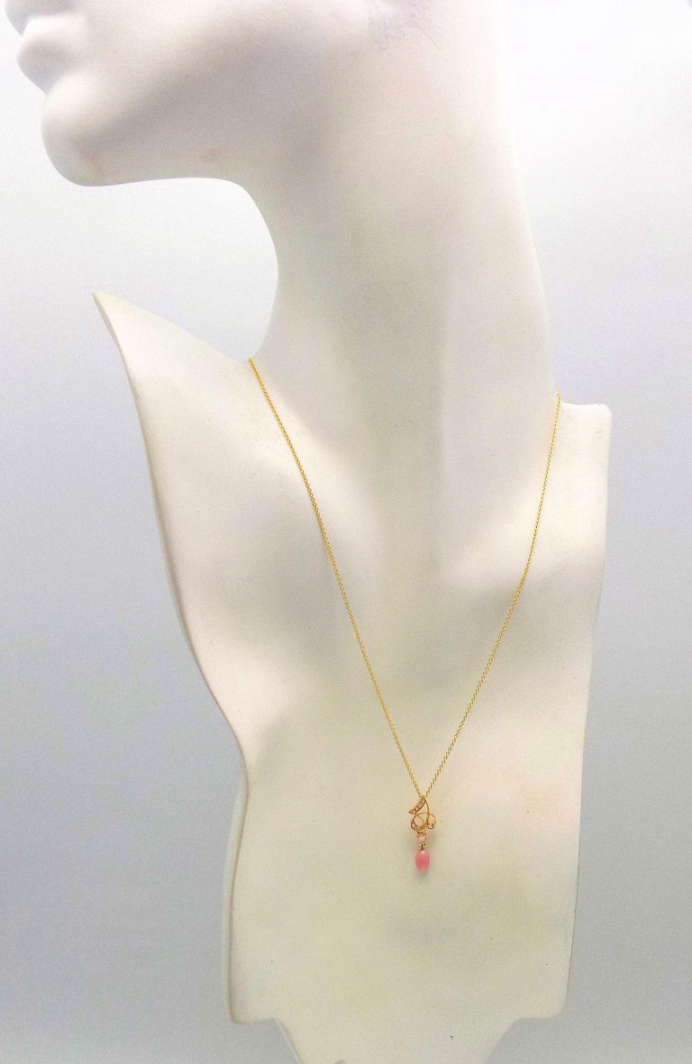 14 Karat Yellow Gold Setting and Chain. Natural Light Pink Conch Pearl with the All-Important Visible Flame. Nice Oval Shape. It Measure 6.9 MM Long X 4 MM Wide.  16