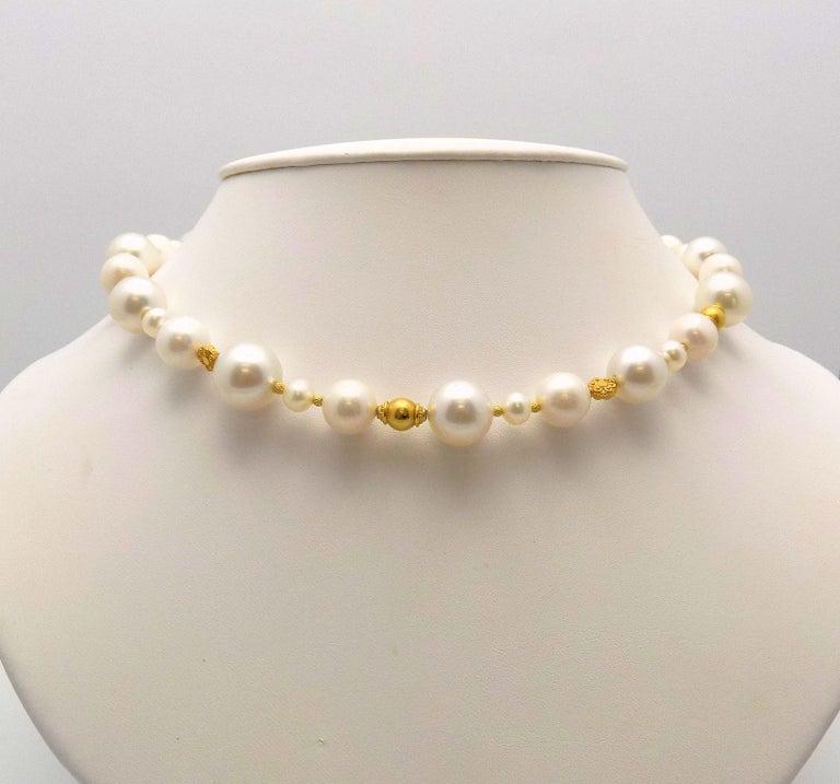 Stunning Strand Necklace of 22 Karat, 18 Karat and 14 Karat Yellow Gold Beads, South Sea Cultured Pearls and Fresh Water Cultured Pearls has 14 Karat Yellow Gold Hook/Eye Closure; 14 X 6.5 MM; 18