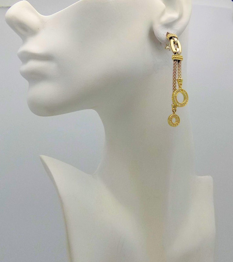 Pair 18 Karat Yellow Gold & Sterling Silver Pendant Clip Earrings Featuring 68 Round Brilliant Diamonds 0.75 Carat Total Weight SI, H. Signed: Lagos Caviar. 2.75