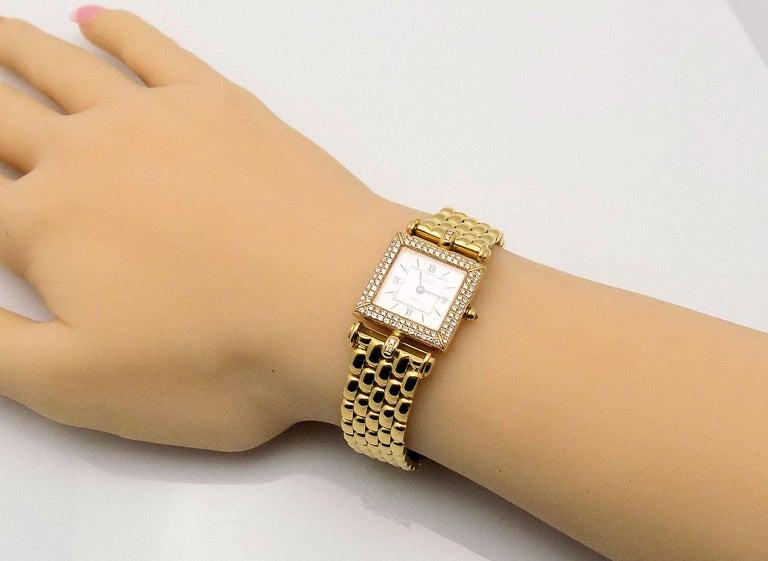 Classic 18 Karat Yellow Gold Lady's Van Cleef & Arpel Classique Wrist Watch Featuring 100 Round Brilliant Diamonds 0.50 Carat Total Weight VS, G, 18 Karat Yellow Gold Mesh Band, 11 Assorted Bands, 6.5