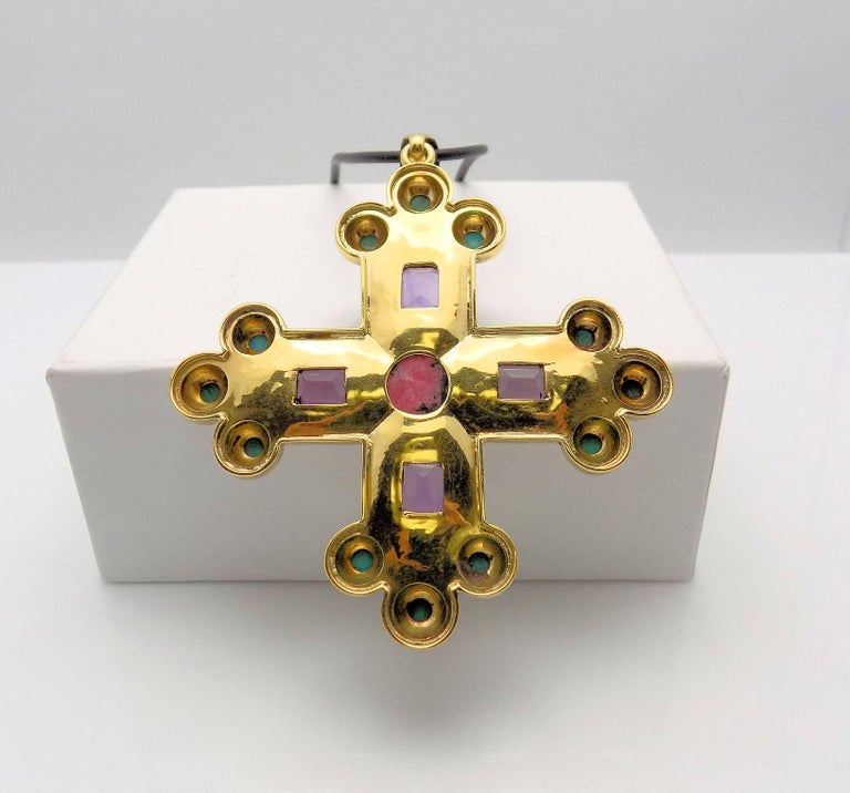 Gothic Style 14 Karat Yellow Gold Textured Cross Pendant 9 MM Round Cabochon Rhodochrosite; 4 Emerald Cut Amethysts 7.00 Carat Total Weight; (4) 3 MM Round Cabochon Malachite; (8) 3 MM Cabochon Turquoise; Signed: SANZ. 19.9 DWT or 30.95 Grams;