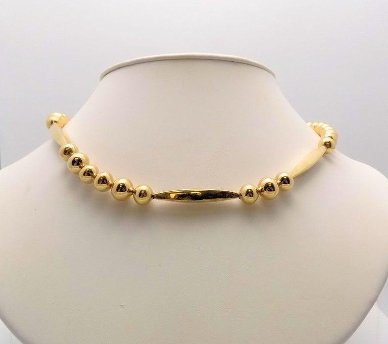 Distinctive 14 Karat Yellow Gold Bead Necklace, 4 Tubular Beads, 32 Round 8 MM Beads, 20