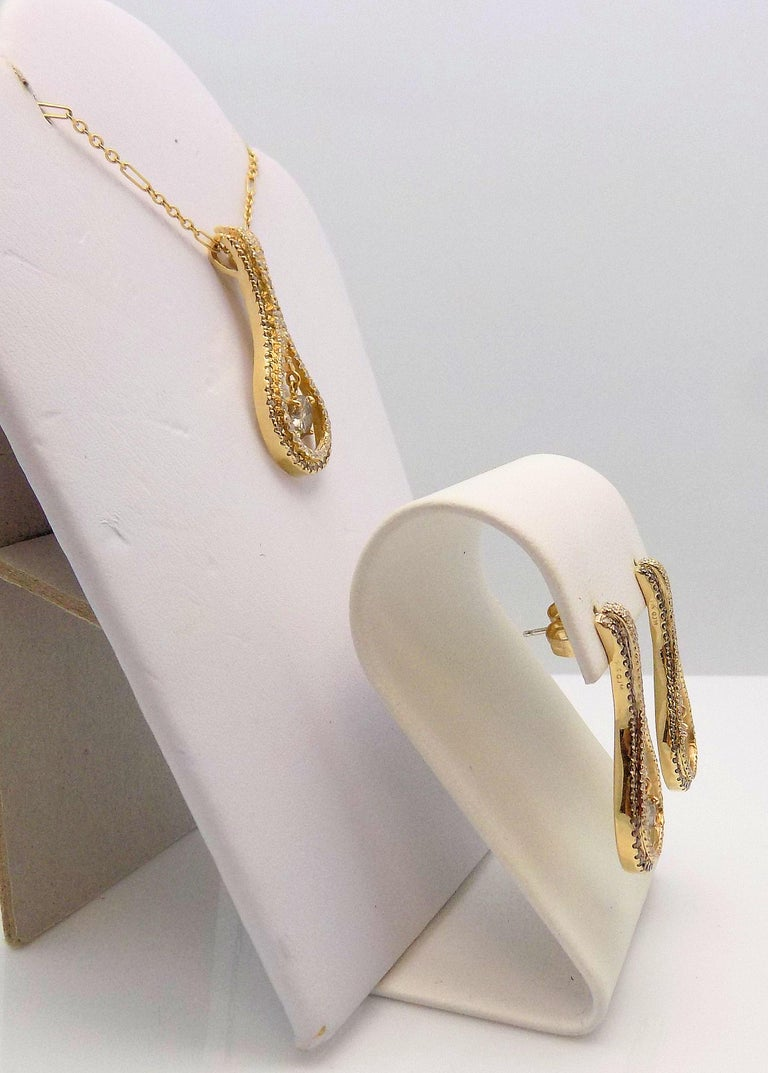 14 Karat Yellow Gold Diamond Pendant (No Chain - shown on chain for display purposes only) and Diamond Earrings Set - Pendant features 1 Round Brown Diamond 0.79 Carat; 47 Round Brilliant Brown Diamonds; 54 Round Brilliant Diamonds 0.51 Carat Total