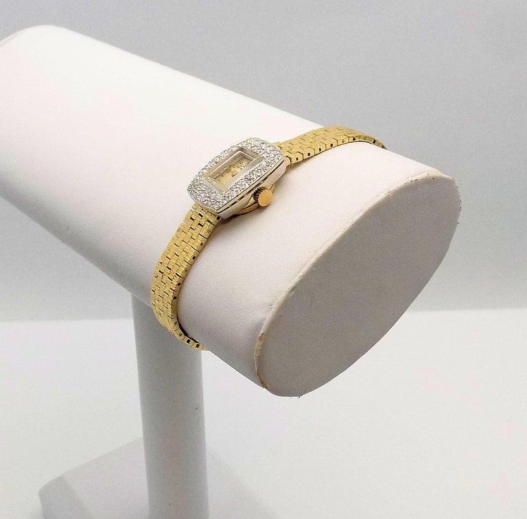 Classically Designed 14 Karat Yellow Gold Ladies Wrist Watch by Girard Perregaux featuring 48 Round Brilliant Diamonds 0.72 Carat Total Weight, VS, G; 6.5