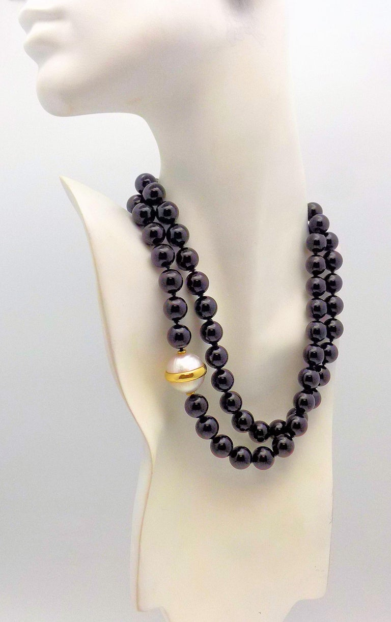 Classic 33 inch Black Onyx Bead Necklace, each bead measures 12mm, accented by 18 Karat Yellow Gold Trimmed Double Mabé Pearl measuring 18mm; Signed: Tiffany & Co Paloma Picasso 1981.